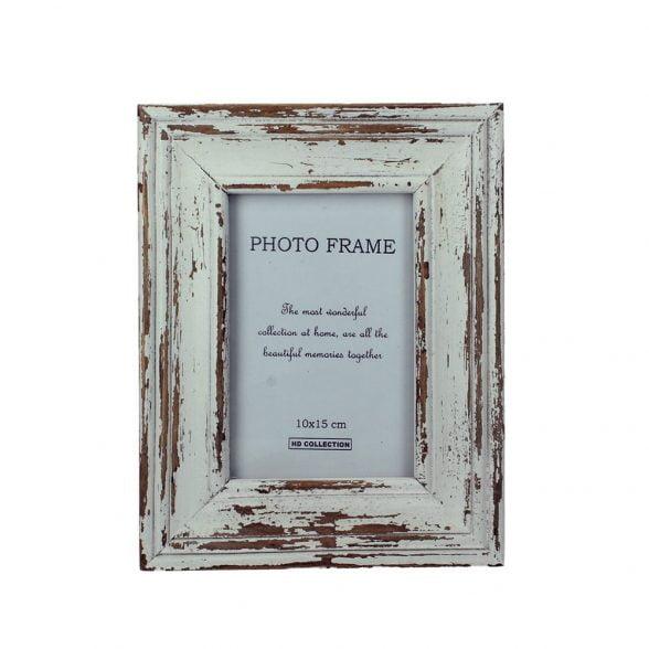 Fotoram i trä med antik finish. Bildmått 9,5x14,5 cm, mått inklusive ram 18x23 cm.