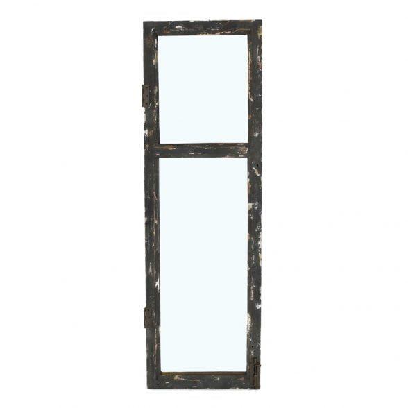 Spegel i form av ett fönster med ram i patinerat svartmålat trä, mått 105x33 cm.