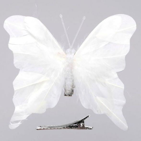 Fjäril av vita syntetiska fjädrar med klämma, set med 3 st. Mått 11x10 cm.