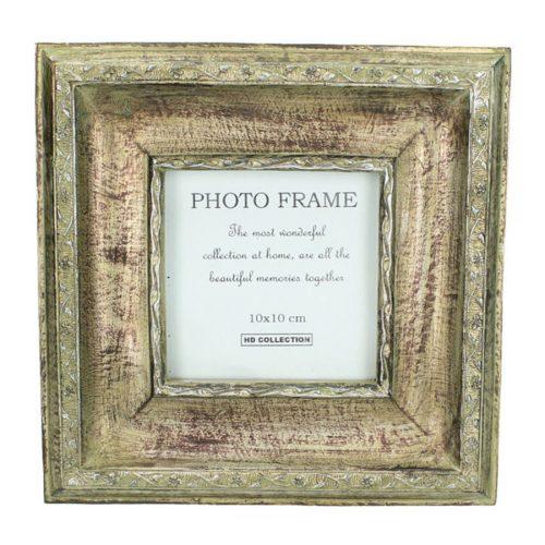 Fotoram i polyresin. Mått bildyta 10x10 cm, ramens mått är 19x19 cm.