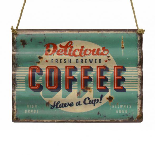 Tavla i korrugerad plåt med kaffemotiv, mått 40x30 cm.