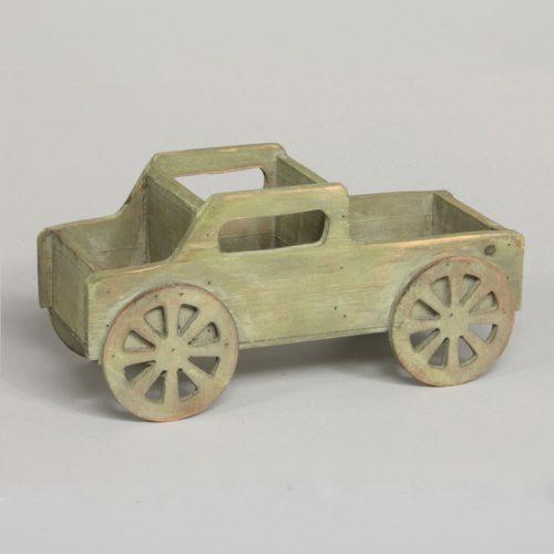 Träbil med plats för förvaring. Kan t ex användas till skrivbordet eller för diverse småsaker. Mått 30x12,5x14 cm.