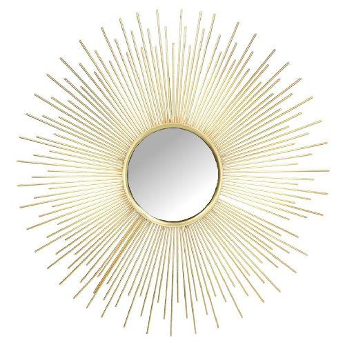 Solspegel med ram i guldfärgad metall. Diameter 53 cm.