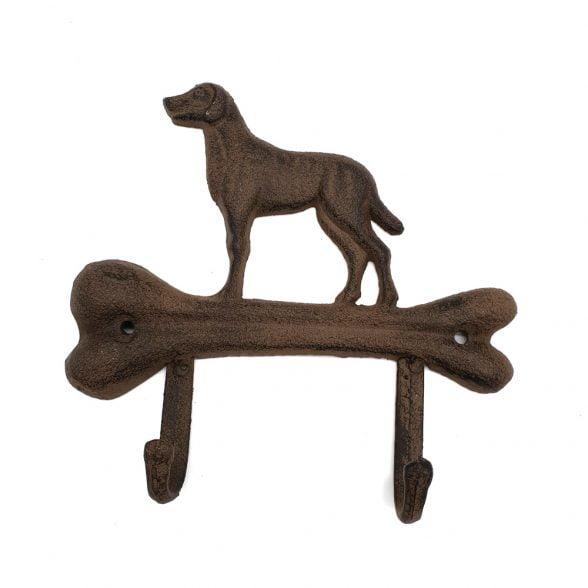 Hängare i gjutjärn med två krokar och dekor av hund. Mått 18x17 cm.