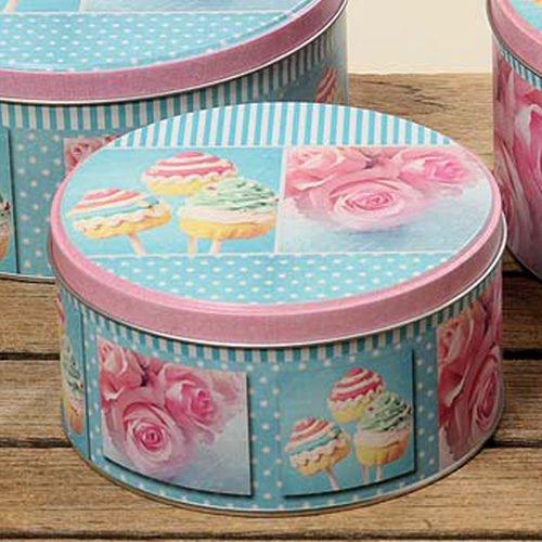Plåtburk med motiv av rosor och cupcakes. Diameter 14 cm, höjd 7,5 cm.