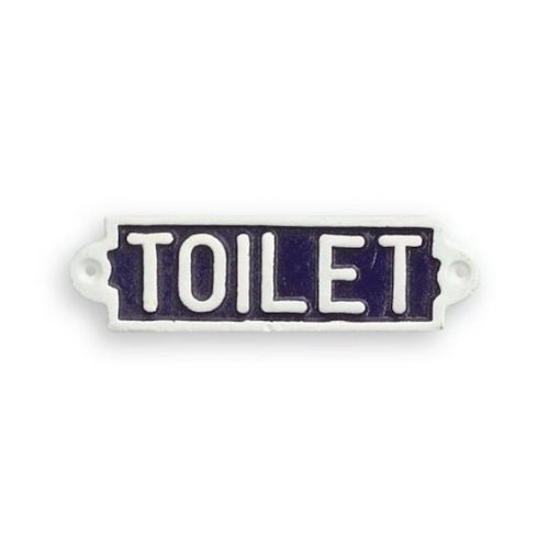 Skylt i bemålat gjutjärn med texten Toilet, mått 17,5x5 cm.